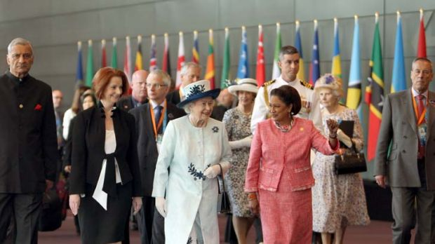 Walk and talk ... the Queen leaves the CHOGM meeting yesterday with Julia Gillard and the Prime Minister of Trinidad and ...