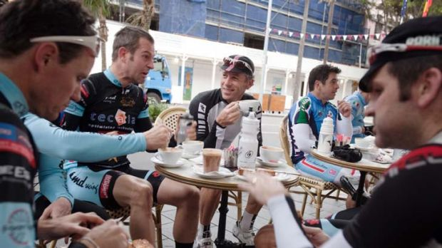 The spirit is wheeling ... members of the Manly Warringah Cycling Club bond over coffee.