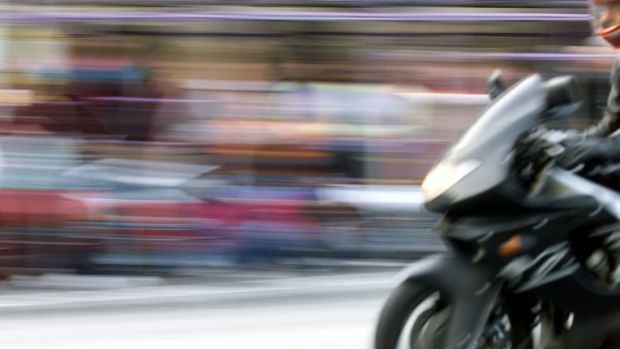 A woman crashed after chasing an alleged motorbike thief.