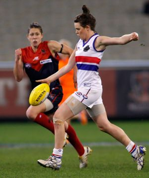 Elise O'Dea representing the Western Bulldogs in 2013. This year she will play with Melbourne Demons.