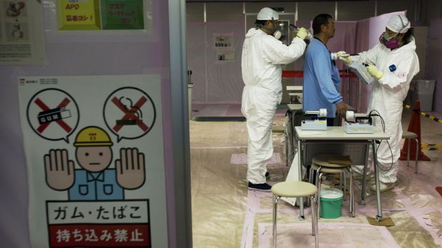 A workers is given a radiation screening as he enters the emergency operation centre at the crippled Fukushima Dai-ichi ...