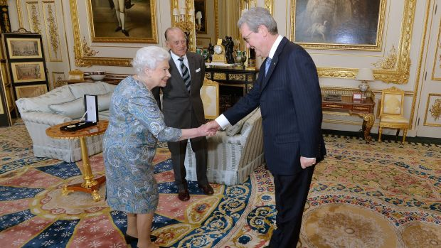 The Queen shakes hands with the Australian High Commissioner Alexander Downer.