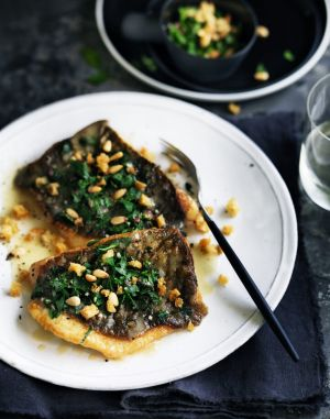 Pan-fried John Dory with parsley garlic and pine nuts.