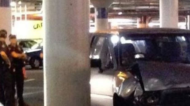 A woman is dead after being trapped under a car at a Brisbane shopping centre.