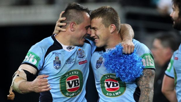 A game of two halves: Josh Reynolds and Trent Hodkinson share a moment after winning back the Origin trophy last year.
