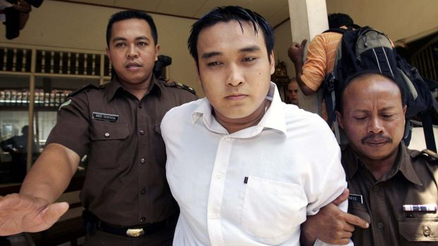 Australian Tan Duc Thanh Nguyen is led into a Denpasar courtroom during his trial for drug smuggling.