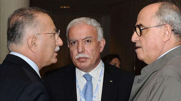 Foreign Minister of the Palestinian Authority, Riyad Al-Malki, centre, speaks to members of the Palestinian delegation.