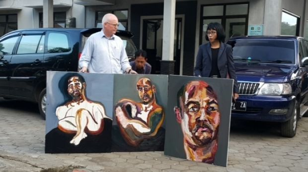 """Australian lawyer Julian McMahon with three self-portraits by Sukumaran: """"The 72 hours just started"""", """"Strange Day"""" and ..."""