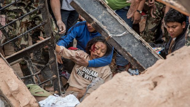 Emergency rescue workers find a survivor in the debris of Dharara tower after it collapsed on April 25, 2015 in Kathmandu.