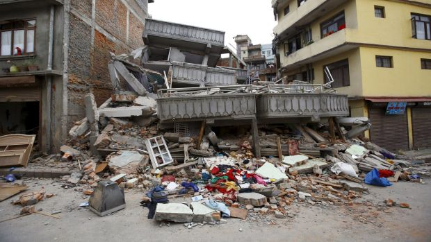 A collapsed building is pictured after an earthquake hit, in Kathmandu, Nepal.