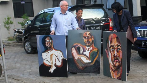 "Bali nine lawyer, Julian McMahon, with three recent paintings by Myuran Sukumuran, among them one marked ""Self Portrait, ..."
