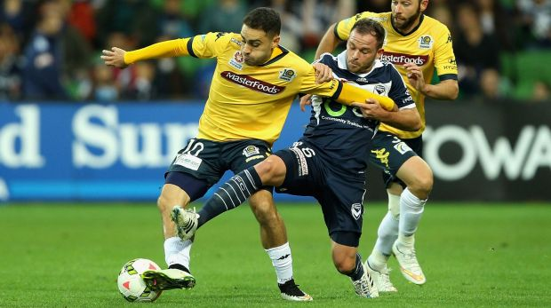 Fine footwork: Anthony Caceres of Central Coast and Leigh Broxham of Melbourne compete.