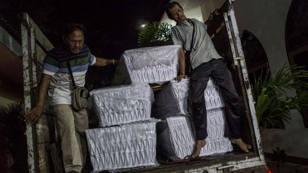 Coffins are loaded on trucks at the Bali;s port city Cilacap in central Java in anticipation of the Bali duo's execution.