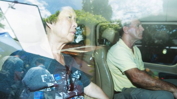 Michael Chan's mother Helen Chan leaving Wijaya Pura in Cilacap ahead of her son's impending execution.