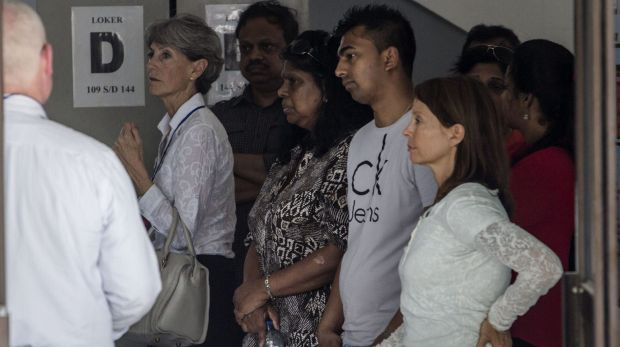 Myuran Sukumaran's mother Raji Sukumaran, centre, and his brother Chinthu Sukumaran, second from right, at Wijaya Pura ...