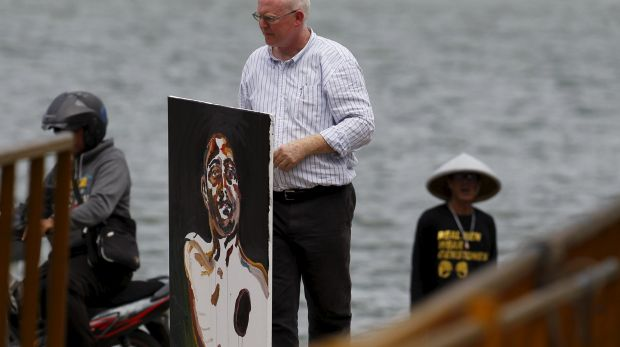Lawyer Julian McMahon carries what will be the final self-portrait painted by Myuran Sukumaran.