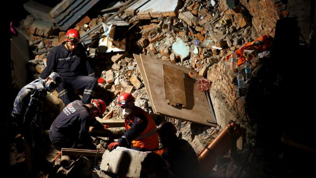 Rescue team members from Turkey, China and Nepal search through rubble in Kathmandu.