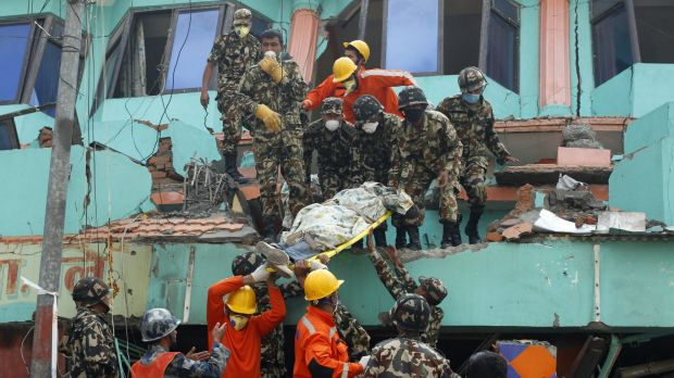 Nepalese and Indian rescue teams remove a body from the collapsed Sitapyla church in Kathmandu, Nepal on Monday.