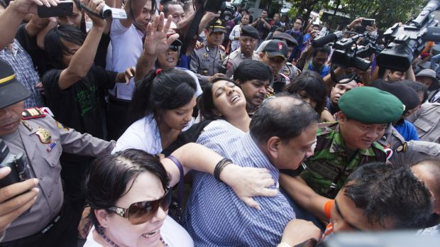Myuran Sukumaran's sister, Brintha, is overcome on her way to Nusakambangan island.