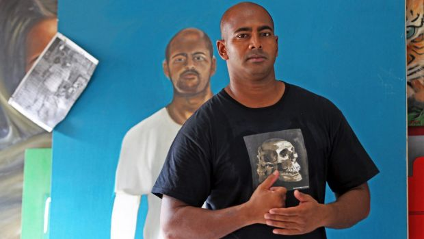 Myuran Sukumaran with a portrait of himself painted by another inmate at Kerobokan during painting classes with Ben Quilty.