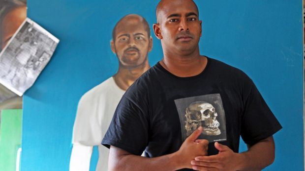 Myuran Sukumaran with a portrait of himself painted by another inmate at Kerobokan Prison.
