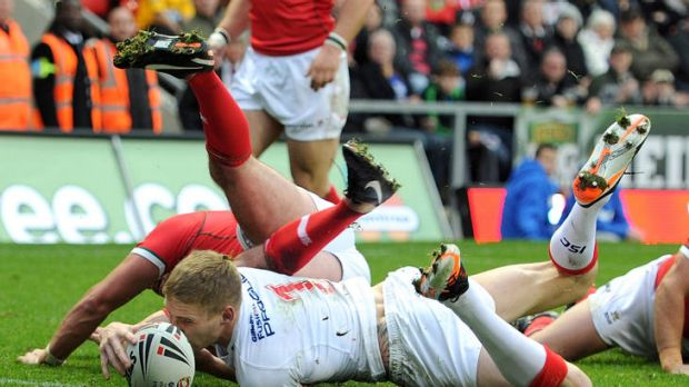 Danger man ... Sam Tomkins goes over for a try against Wales.