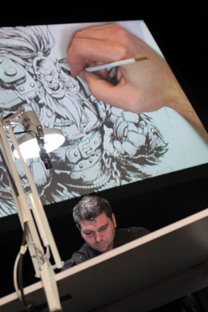 Blizzard artist Trent Kaniuga is seen on the artists stage at BlizzCon.