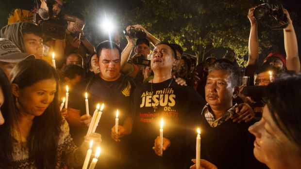 A midnight candlelight vigil at Cilicap held to coincide with the execution of Andrew Chan and Myuran Sakamaran and six ...