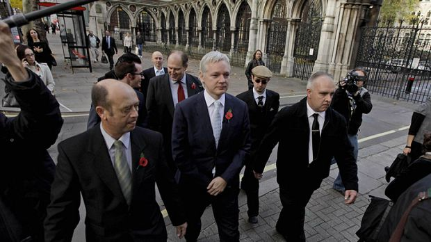 WikiLeaks founder Julian Assange, centre, arrives for his hearing at the High Court in London today.