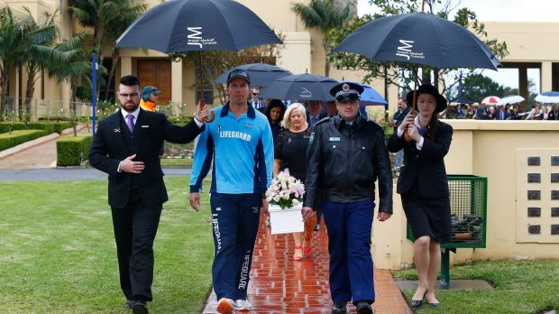 Lifeguard Brad Rope and police officer Andrew Carter carry Lily Grace's coffin during the baby's funeral.