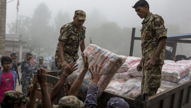 Nepal military personnel load relief supplies onto a truck on Wednesday.