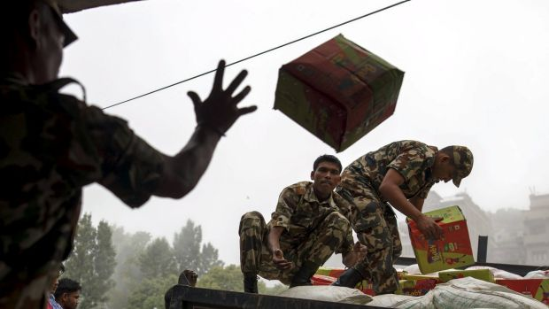 A box of relief supplies thrown on to a truck in Gorkha, Nepal, on Wednesday.
