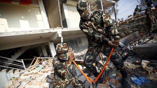 Nepalese soldiers search for earthquake victims on Wednesday.