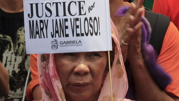 A protester holds a placard calling for justice for Filipina drug convict Mary Jane Veloso during a protest outside the ...