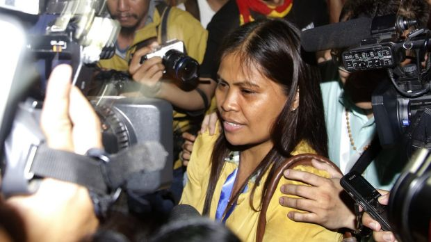 Marites Veloso, Mary Jane Veloso's sister, surrounded by media after visiting her sister on Wednesday.
