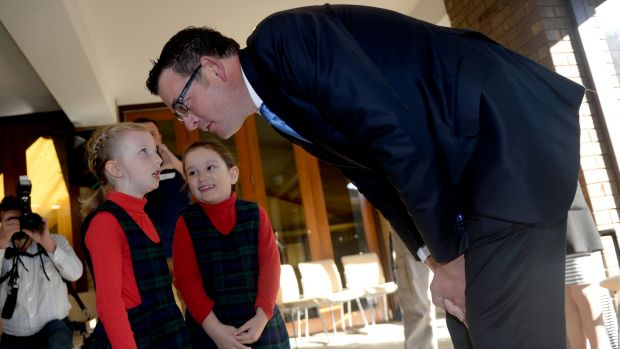 Premier Daniel Andrews sees eye-to-eye with six-year-old Frankie at St Peter's Primary School in East Bentleigh.