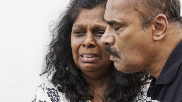 Myuran Sukamaran's parents, Raji and Sam, after saying goodbye to their son.