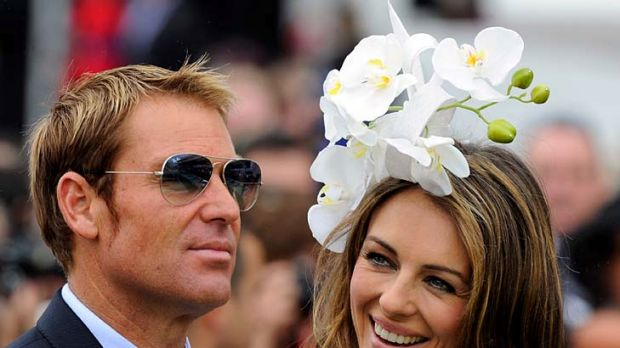 Shane Warne and Liz Hurley at Flemington for Oaks Day yesterday.
