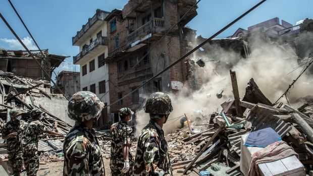A damaged building collapses in Sankhu, Nepal.