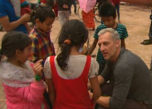 Andrew Rochford talks to children in Nepal.