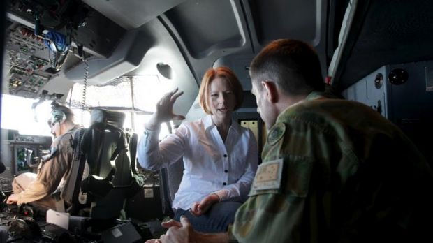Prime Minister Julia Gillard is briefed by Major-General Angus Campbell (right), Commander of Joint Task Force 633, in ...