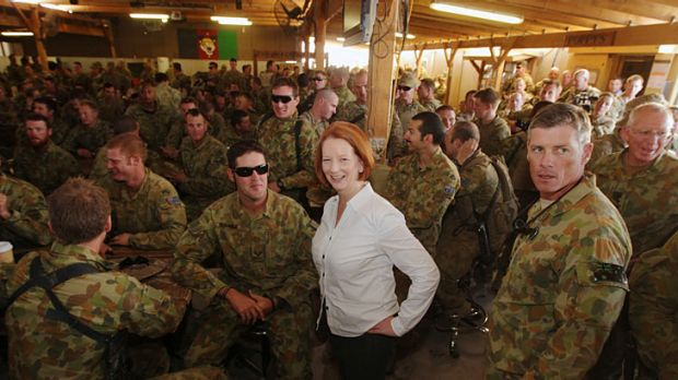 Taste of home … Julia Gillard shares a barbecue with Australian troops at Tarin Kowt as she affirms the ...