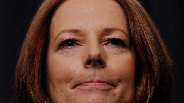 Historic day ... for Julia Gillard, who lost popularity after vowing before the election there would be no carbon tax ...