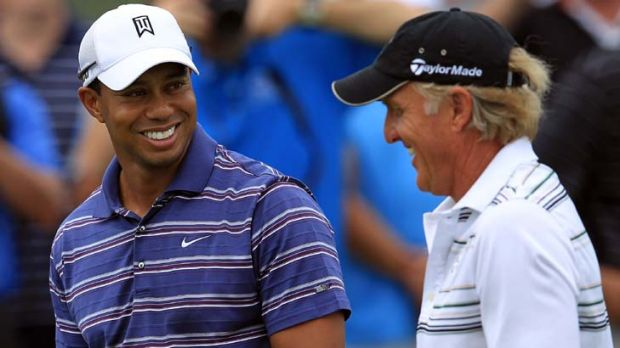 In good spirits ... Tiger Woods shares a joke with Greg Norman yesterday, having earlier cleared the air with his former ...