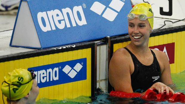 Australia's Emma McKeon, right, celebrates with Australia's Cate Campbell, left, after winning women's 50-metre ...