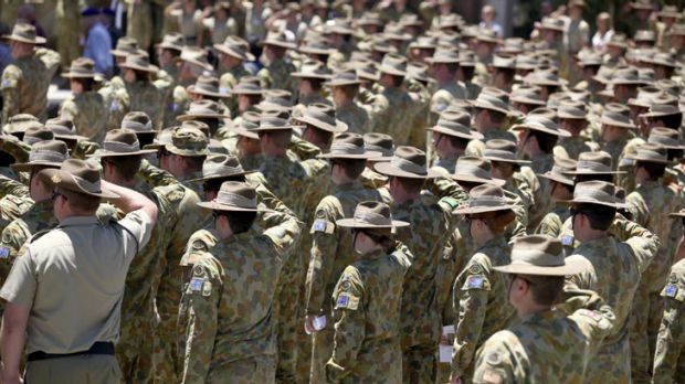 Army personnel salute at the memorial service of Corporal Ashley Birt, who was killed in Afghanistan.