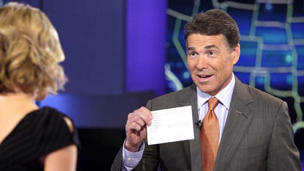 Trying to save his campaign ... Rick Perry appears on  the Fox News Channel.