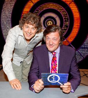 Davies with <i>QI</i> host Stephen Fry.