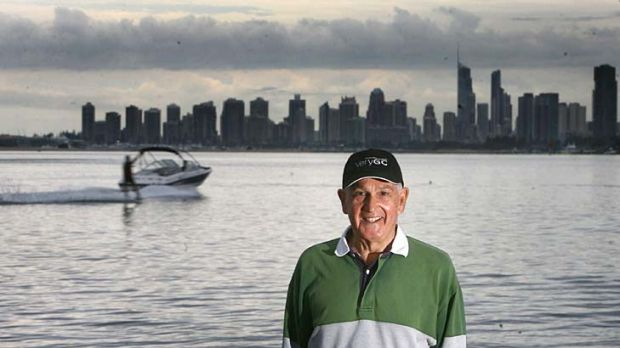 Gold Coast Mayor Ron Clarke poses in front of the early morning backdrop of Surfers Paradise.