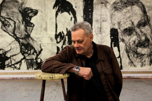 Artist Mike Parr in his studio with his latest large work that depicts his late brother and father.